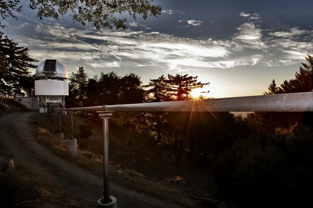 Sunrise over the light pipe at the E1 telescope (Steve Golden).